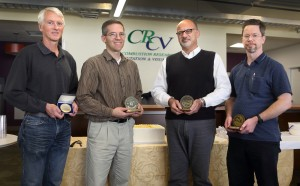 Robert Barlow, left, was awarded the Combustion Institute's Alfred C. Edgerton Gold Medal. To his right are this year's CRF awards recipients, Lyle Pickett, Habib Najm, and Chris Carlen, who were chosen by their peers. (Photos by Dino Vournas)