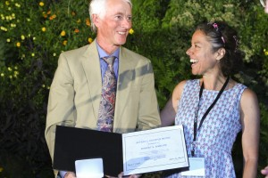 Robert Barlow (left) with former Sandian and current research collaborator Simone Hochgreb of Cambridge University, who presented him with the Alfred C. Egerton Gold Medal at the 35th International Symposium on Combustion.
