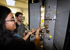 Under the supervision of mentor Ethan Hecht, Samira Iqbal of Las Positas College works on a reactor that is used to characterize the kinetics of pulverized coal oxy-combustion under pressure.