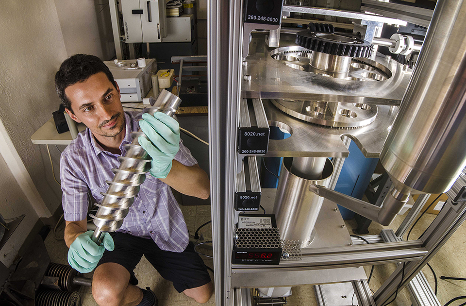 Ivan Ermanoski works on a room-temperature prototype of the packed particle bed reactor for solar-thermochemical hydrogen production. (Photo by Randy Montoya)