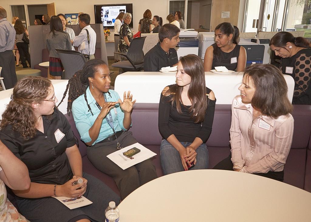 Karla Morris talks with several award recipients.