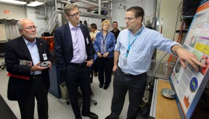 CRF researcher Jeff Koplow, right, explains the Sandia Cooler to Cummins President and CEO Tom Linebarger, on left, and Vice President and CTO John Wall, middle. The pair learned about many Sandia innovations on their visit to the CRF. (Photo by Dino Vournas)