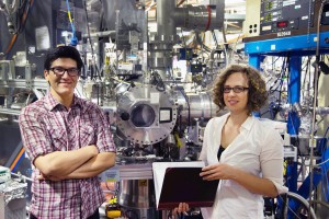 John Savee, left, identified cycloheptadiene as the best fuel for creating a detectable QOOH, and Sandia computational expert Ewa Papajak, right, and her adviser, Judit Zádor, used quantum chemistry to explain the mechanism of the reaction. Savee and Papajak appear in front of an instrument, the Multiplexed Photoionization Mass Spectrometer in the Advanced Light Source at Lawrence Berkeley National Laboratory, that took direct measurements. (Photo by David Osborn)