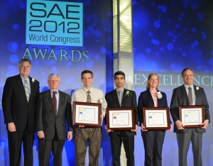 2012 SAE President, Frank O. Klegon and Dr. John H. Johnson, Michigan Technological University, present the 2011 SAE John Johnson Award for Outstanding Research in Diesel Engines to Lyle Pickett, Cherian A. Idicheria, Caroline L. Genzale, and Dennis L. Siebers.