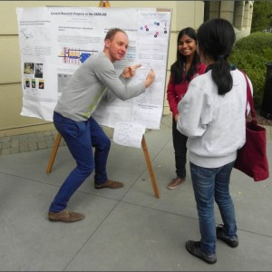Justin Jankunas's passion for science and his animated nature when talking about his work are evident as he explains molecular dynamics results from Stanford's Zare Lab to prospective first-year graduate students during a recruiting weekend. (Photo courtesy of Max Osipov, Stanford University